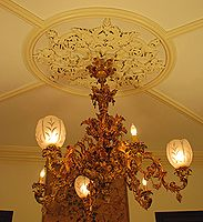 Four-tier brass Victorian chandelier in the John Thompson House.