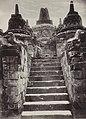 KITLV 40544 - Sem Céphas - Javanese man on the stairs to the stupa terrace at Borobudur - Around 1910.jpg