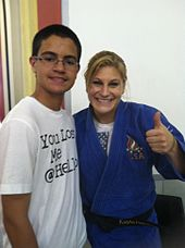 Kayla Harrison with a fan.JPG