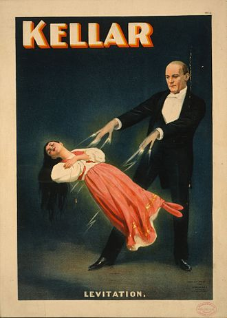 "Psychokinesis - An advertising poster depicting magician Harry Kellar performing the ""Levitation of Princess Karnac"" illusion, 1894, U.S. Library of Congress."