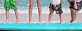 Kids Legs On A Surfboard (6669047263).jpg