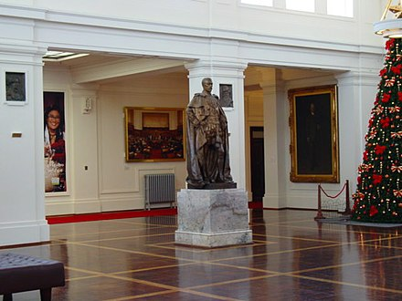 A statue of King George V looks over King's Hall in Old Parliament House, Canberra King's Hall, Old Parliament House, Canberra.JPG