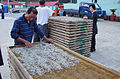 Korea-Heuksando-Inspecting dry anchovie 11-02862.JPG