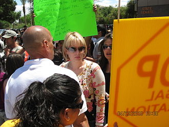 Arizona SB 1070 - State Representative Kyrsten Sinema, opponent of the bill, attending a protest at the Arizona State Capitol on the day of the bill's signing