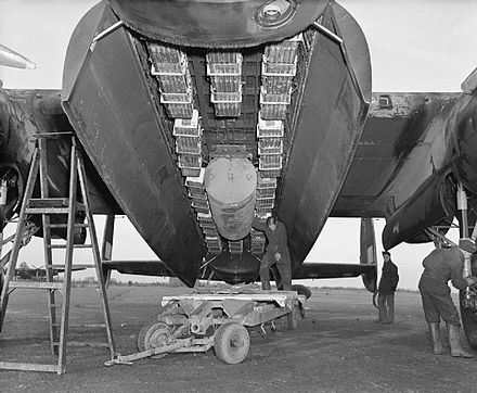 "57 Squadron Avro Lancaster with the ""Usual"" area bombing load of a 4,000 lb (1.8 t) bomb and 12 Small Bomb Containers, each filled with 4 lb (1.8 kg) incendiary bombs"