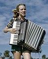 Lois Duncan Steinmetz playing the accordion aboard the shantyboat Lazy Bones (alt crop).jpg