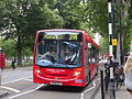 London United DLE25 on Route 391, Turnham Green Church (14372875150).jpg