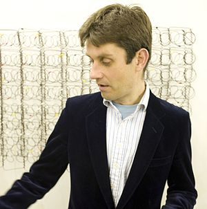 """Lorenzo Belenguer - Belenguer with his work """"Homage to Pollock"""" at the back"""