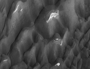 Lyot (Martian crater) - Lyot Crater Dunes, as seen by HiRISE.  Click on image to see light toned deposits and dust devil tracks.