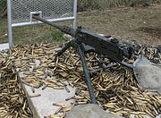 A .50 caliber M2 machine gun surrounded by spent shell casings: John Browning's design has been one of the longest serving and successful machine gun designs