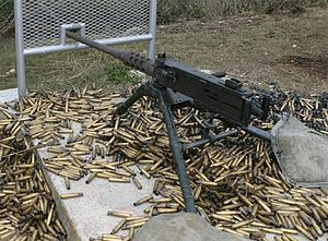 Automatic firearm - A M2 Browning machine gun, surrounded by ejected cartridge cases