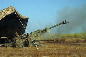 2nd Battalion, 11th Marines - Marines with 2/11, send a round high into the air with the new M777 howitzer.