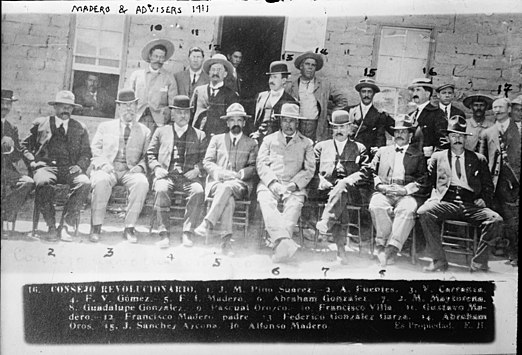 Northern leaders of the revolt against Diaz pose for a photo after the First Battle of Juarez. Present are Jose Maria Pino Suarez, Venustiano Carranza, Francisco I. Madero (and his father), Pascual Orozco, Pancho Villa, Gustavo Madero, Raul Madero, Abraham Gonzalez, and Giuseppe Garibaldi Jr. Madero avisors.jpg
