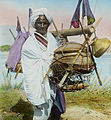 Man with shoulder pole, India, ca. 1920 (IMP-CSCNWW33-OS16-80).jpg