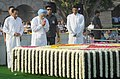 Manmohan Singh paying homage at the Samadhi of Mahatma Gandhi on his 143rd birth anniversary, at Rajghat, in Delhi on October 02, 2012. The Union Minister for Urban Development, Shri Kamal Nath is also seen.jpg