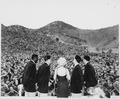 Marilyn Monroe sings several songs for an estimated 13,000 men of the First Marine Division. Miss Monroe stopped at... - NARA - 532471.tif