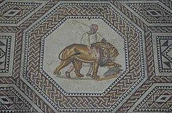 Mosaïque romaine représentant un lion, probablement un lion de l'Atlas, dans les arènes