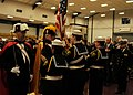 Members of the Knights of Columbus pass the Ensign to members of the Naval Sea Cadet Corps, Kitsap Battalion.jpg