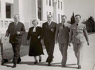 Menzies Government (1949–66) - Sir Robert Menzies, Dame Enid Lyons (the first woman member of an Australian Cabinet), Sir Eric Harrison, Harold Holt (Menzies' successor) and an Airforceman in 1946.