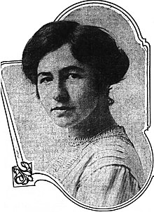 Shoulder-length formal portrait of a dark-haired woman in her late 20s.