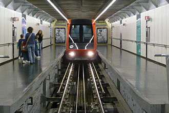 Montjuïc Funicular - Car entering Paral·lel station, showing track and haulage cables