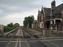 View along the railway tracks from the level crossing.