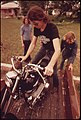 Motorcyclist from Leakey, Texas, Loads His Cycle on a Truck with the Help of Friends near San Antonio, 05-1973 (3704383410).jpg
