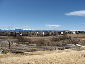 Houses in Westminster, with the Rocky Mountains in the background