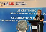 Mrs. Pham Hoai Giang of USAID HIV Workplace Project speaks at the completion event. (9089613957).jpg