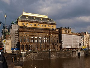 Národní divadlo theatre in Prague viewed from across the water.jpg