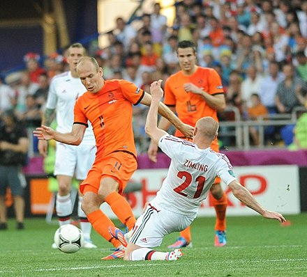Dutch star football players Arjen Robben and Robin van Persie during a game with the Netherlands national football team against Denmark national football team at Euro 2012 NED-DEN Euro 2012 (10).jpg