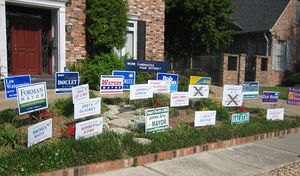 """New Orleans mayoral election, 2006 - New Orleans house with a collection of signs for all the mayoral candidates, with the comment """"More candidates than voters?"""""""