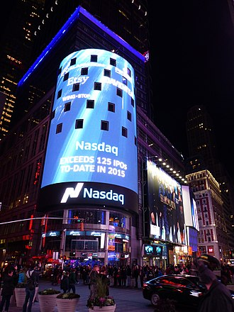 4 Times Square - NASDAQ MarketSite at the bottom of the Condé Nast Building at night