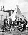Native American men, women and children in ceremonial dress in front of tipi, Lewis and Clark Exposition, Portland, 1905 (AL+CA 2186).jpg