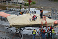 Naval Facilities Engineering Command personnel prepare to load a U.S. Navy X-47B Unmanned Combat Air System demonstrator aircraft onto the flight deck of the aircraft carrier USS George H.W. Bush (CVN 77) 130506-N-FU443-168.jpg