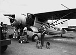 Noorduyn Norseman aircraft refuelling on the airstrip, possibly at Eagle Farm, 1948 (5575838784).jpg