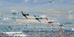 Air racing - T-6 Gold Start passing the finish pylon at the 2014 Reno Air Races