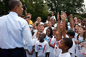 Let's Move! - President Barack Obama meets with children from a Let's Move! tennis clinic on the South Lawn of the White House.