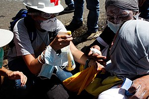 Tear gas - An medic tending to an opposition protester during the 2014 Venezuelan protests