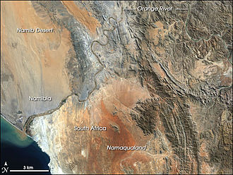 Orange River - This image shows only the last c. 100 kilometers of the Orange River. In this last stretch the gravel deposits in the river bed and along the banks are rich with diamonds, and several diamond mines operate along the stretch pictured here.