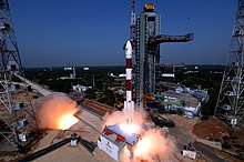 A PSLV-CA launch vehicle begins to lift off from its pad