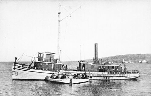 PSM V45 D085 A menhaden steamer receiving a purse seine haul.jpg