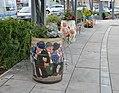 Painted wine barrels as flower planters, Oberpullendorf.jpg