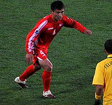 Pak Nam Chol plays with Brasil team. FIFA 2010 World Cup.jpg