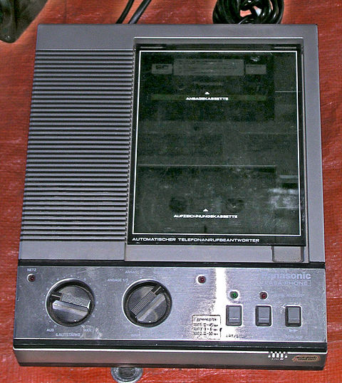 A Panasonic answering machine with a dual compact cassette tape drive to record and replay messages Panasonic-Anrufbeantworter.jpg