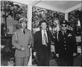 "Photograph of Secretary of the Army Gordon Gray (center) preparing to leave the ""Little White House,"" President... - NARA - 199047.tif"