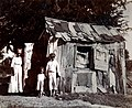 Photograph taken to demonstrate some of the worst housing conditions in British Antigua, 1914.jpg