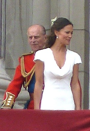 Pippa Middleton - Middleton stands with the Royal Family as maid of honour at the wedding of her sister and Prince William, as Prince Phillip looks on