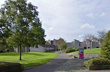 late 1960s new town terraced housing in Glenrothes complete with concrete urban sculpture and segregated public footpath using Radburn housing layout technique