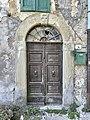 Porta della canonica della chiesa di Santa Margherita a Mangona.jpg